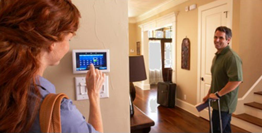 Woman looking at thermostat