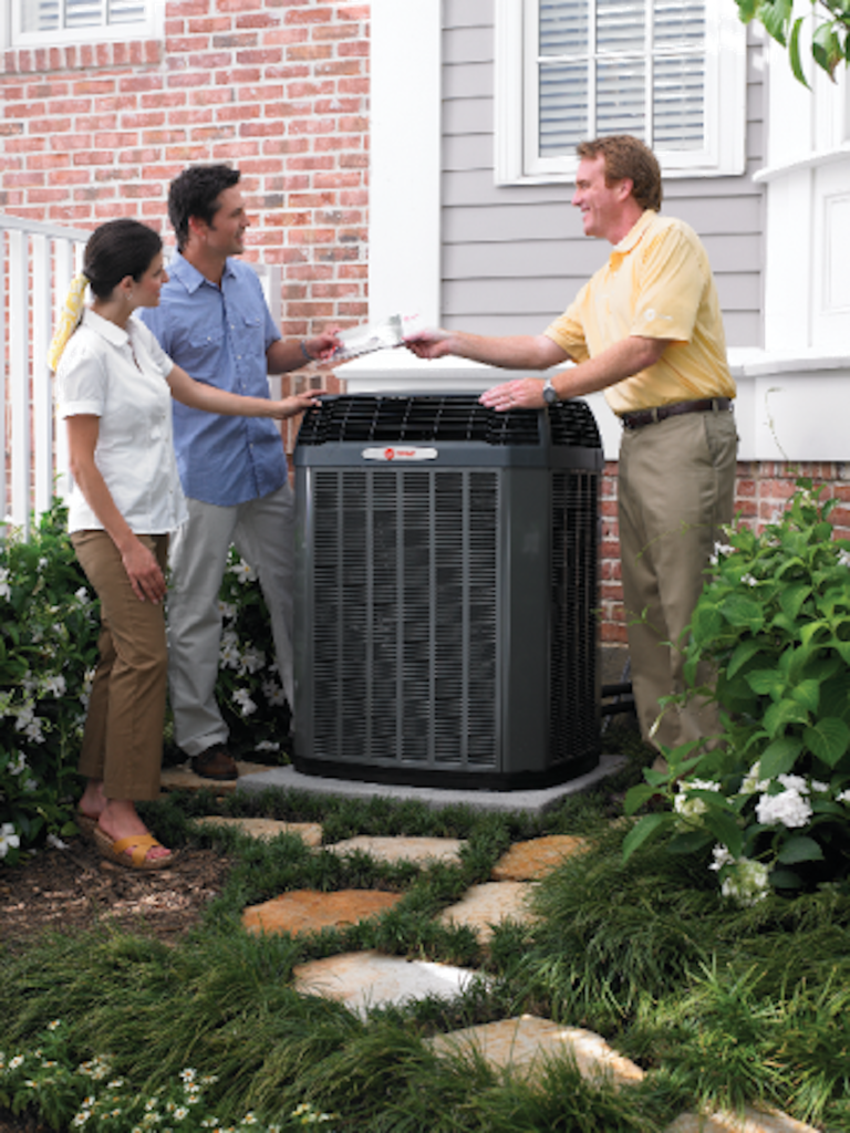 Dealer and homeowners outside with Air conditioner
